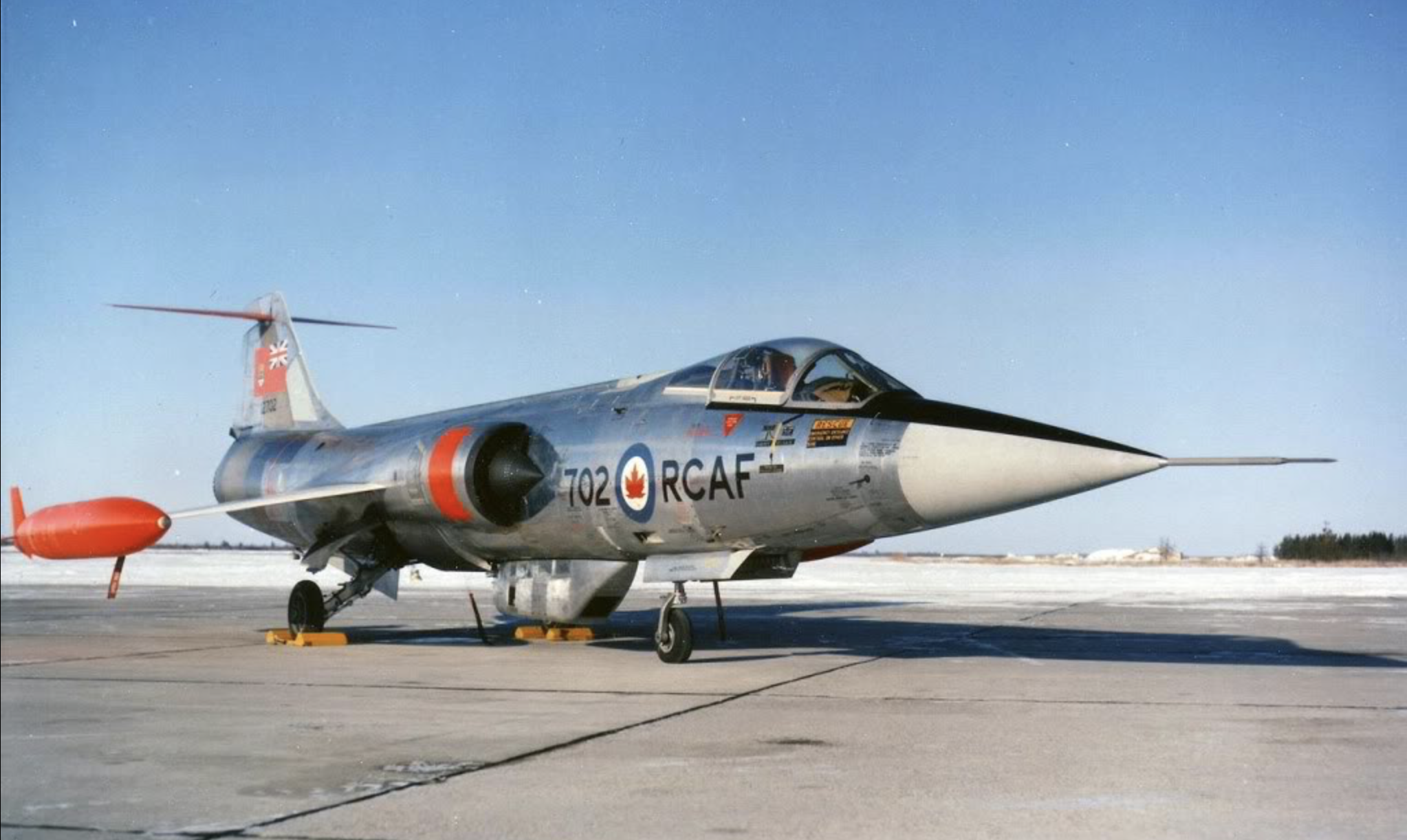 Canada's CF-104s wore bare metal with white wings in the nuclear strike role.